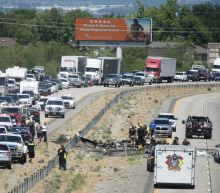 Small plane misses cars but kills 4 aboard in highway crash