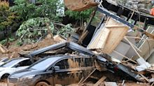 Three New Zealanders killed after holiday home buried in landslide