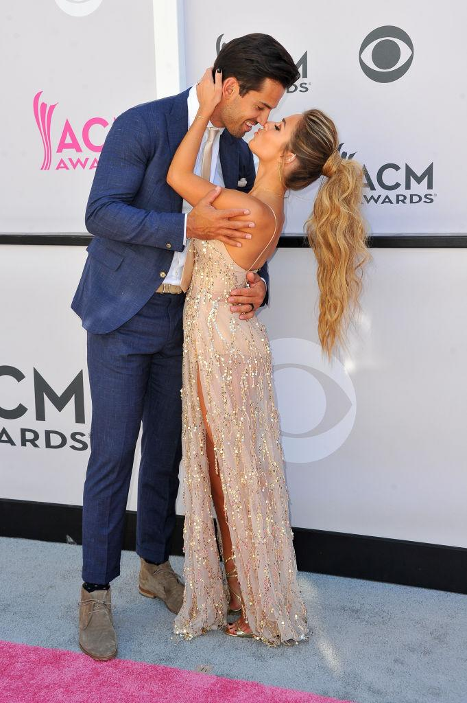 Eric Decker and his wife Jessie James Decker on the ACM Red Carpet wearing the Abyss by Abby Casino Royale gown