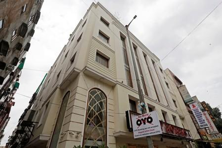 A sign against Oyo is seen outside a hotel in New Delhi