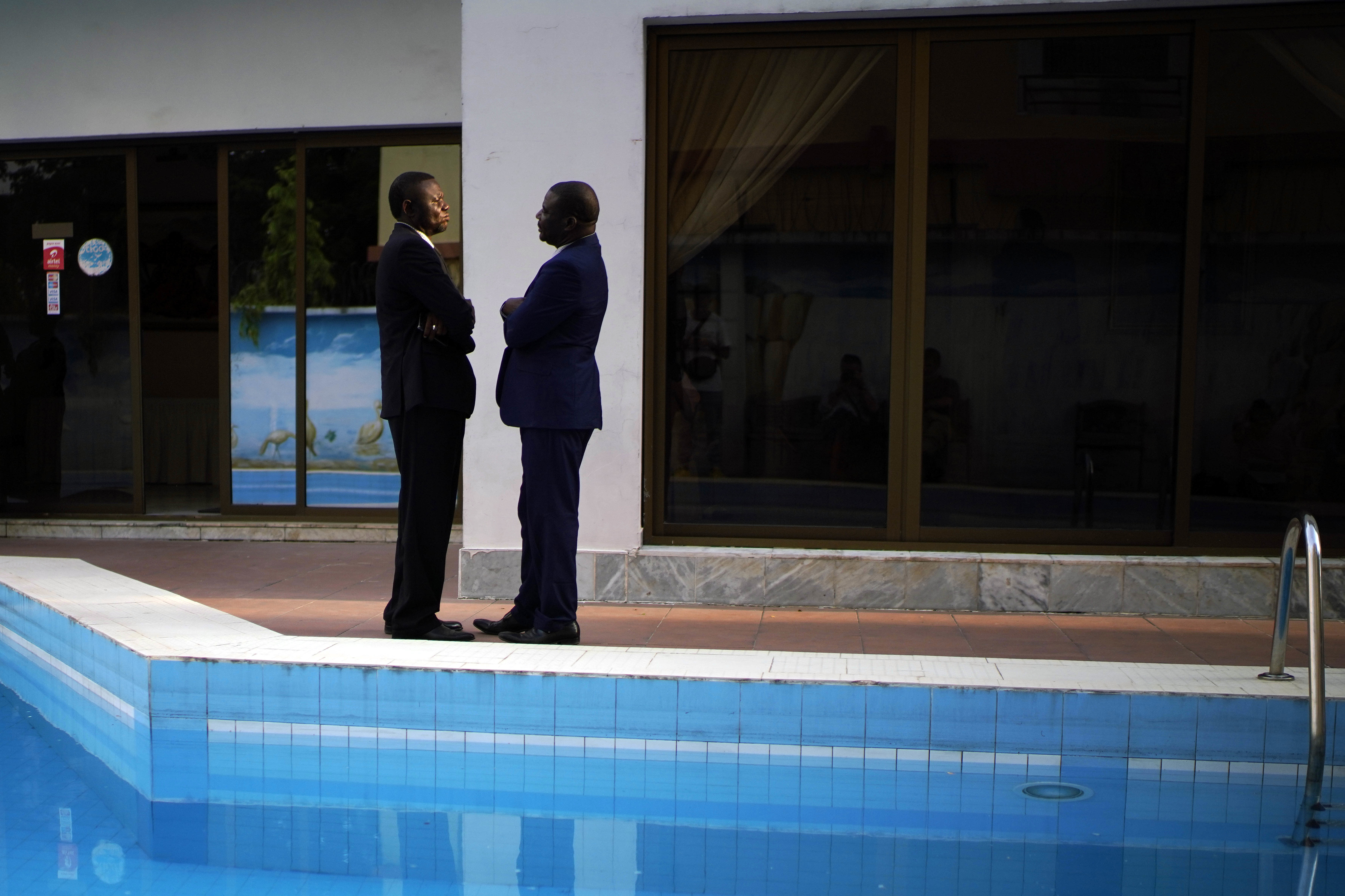 Members of the Congolese opposition coalition Lamuka, led by presidential candidate Martin Faluyu, have a conversation while waiting for a statement to be issued on the timing of the release of the presidential election results in Kinshasa, Congo, Saturday Jan. 5, 2019. Congo faces what could be its first democratic, peaceful transfer of power since independence from Belgium in 1960, but election observers and the opposition have raised numerous concerns about voting irregularities as the country chooses a successor to longtime President Joseph Kabila. (AP Photo/Jerome Delay)