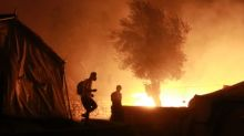 Thousands flee fire at migrant camp on coronavirus lockdown in Greece