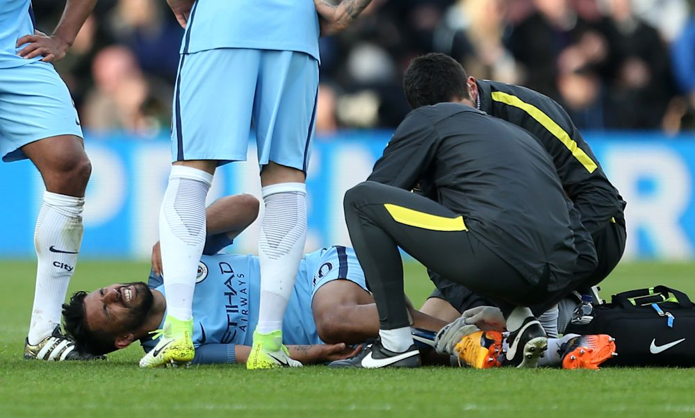 Manchester City's Sergio Aguero receives treatment to an injury