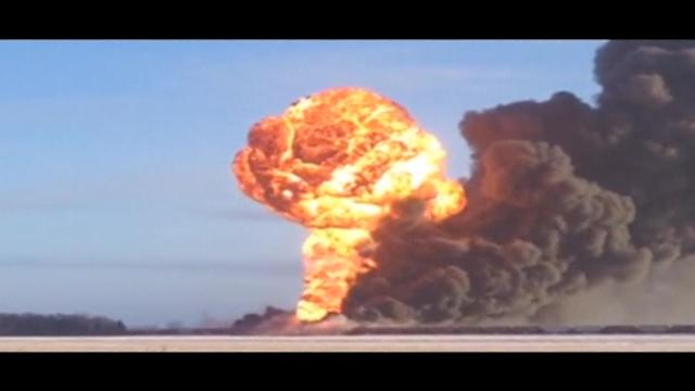 Collision with train carrying crude oil causes massive explosion