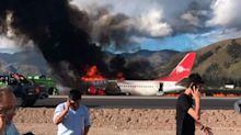 Passengers miraculously escape unharmed after plane bursts into flames on runway