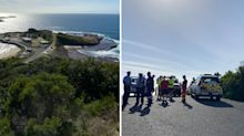 Three men killed after large wave sweeps crowd into sea