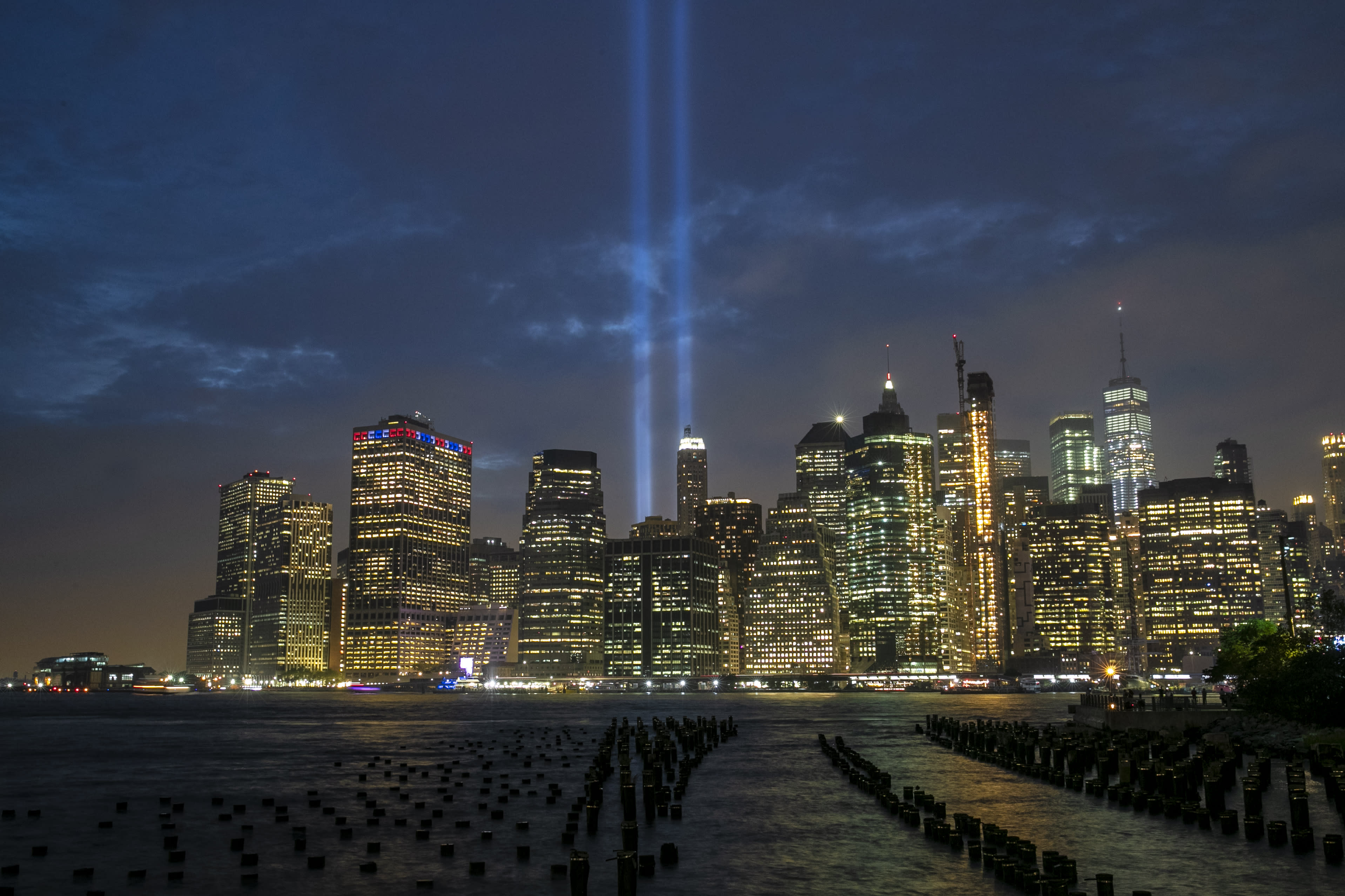 <p>The Tribute in Light rises above the New York skyline from the Brooklyn side of the East River on Sept. 5, 2018. (Photo: Gordon Donovan/Yahoo News) </p>
