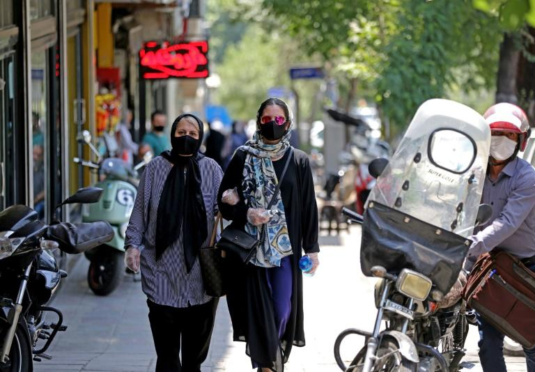 COVID-19 has killed more than 12,000 people and infected over 248,000 in Iran, with daily fatalities reaching a record of 200 early this week, according to official figures (AFP Photo/ATTA KENARE)
