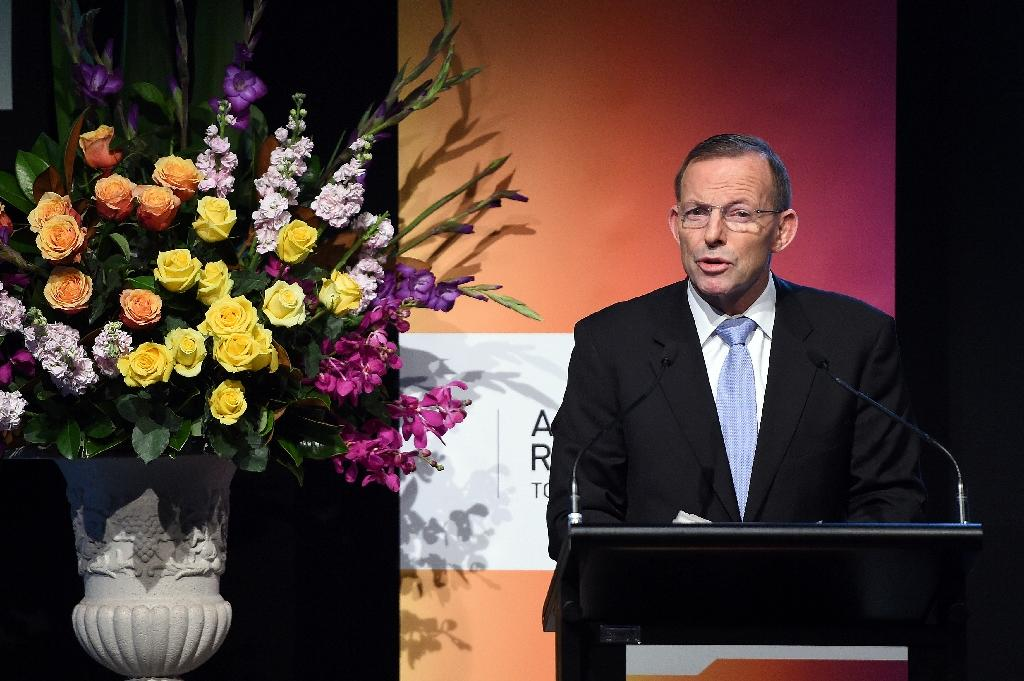 Australian Prime Minister Tony Abbott speaks during a summit in Sydney, on June 11, 2015 (AFP Photo/Saeed Khan)