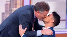 'That felt worryingly good!': Piers Morgan kisses Peter Andre on the lips