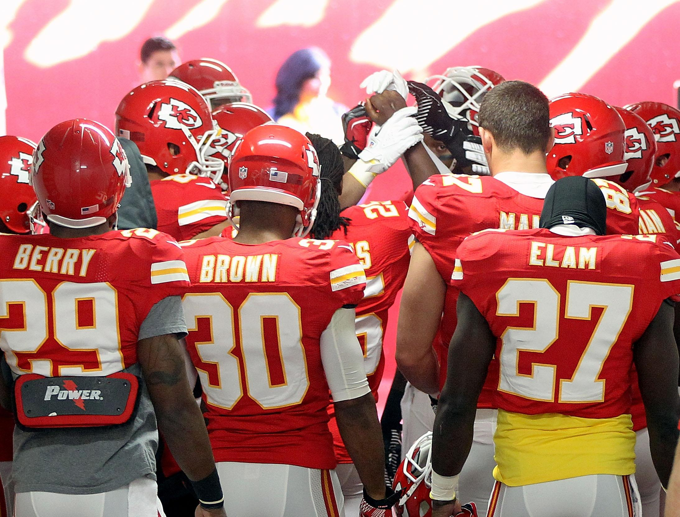 KANSAS CITY, MO - DECEMBER 02: Kansas City Chiefs players huddle in prayer in the tunnel to the field prior to the game against the Carolina Panthers at Arrowhead Stadium on December 2, 2012 in Kansas City, Missouri. (Photo by Jamie Squire/Getty Images)