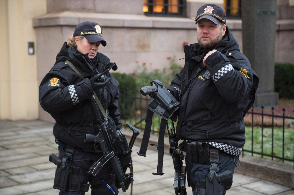 Armed police officers are seen in Oslo on December 9, 2014