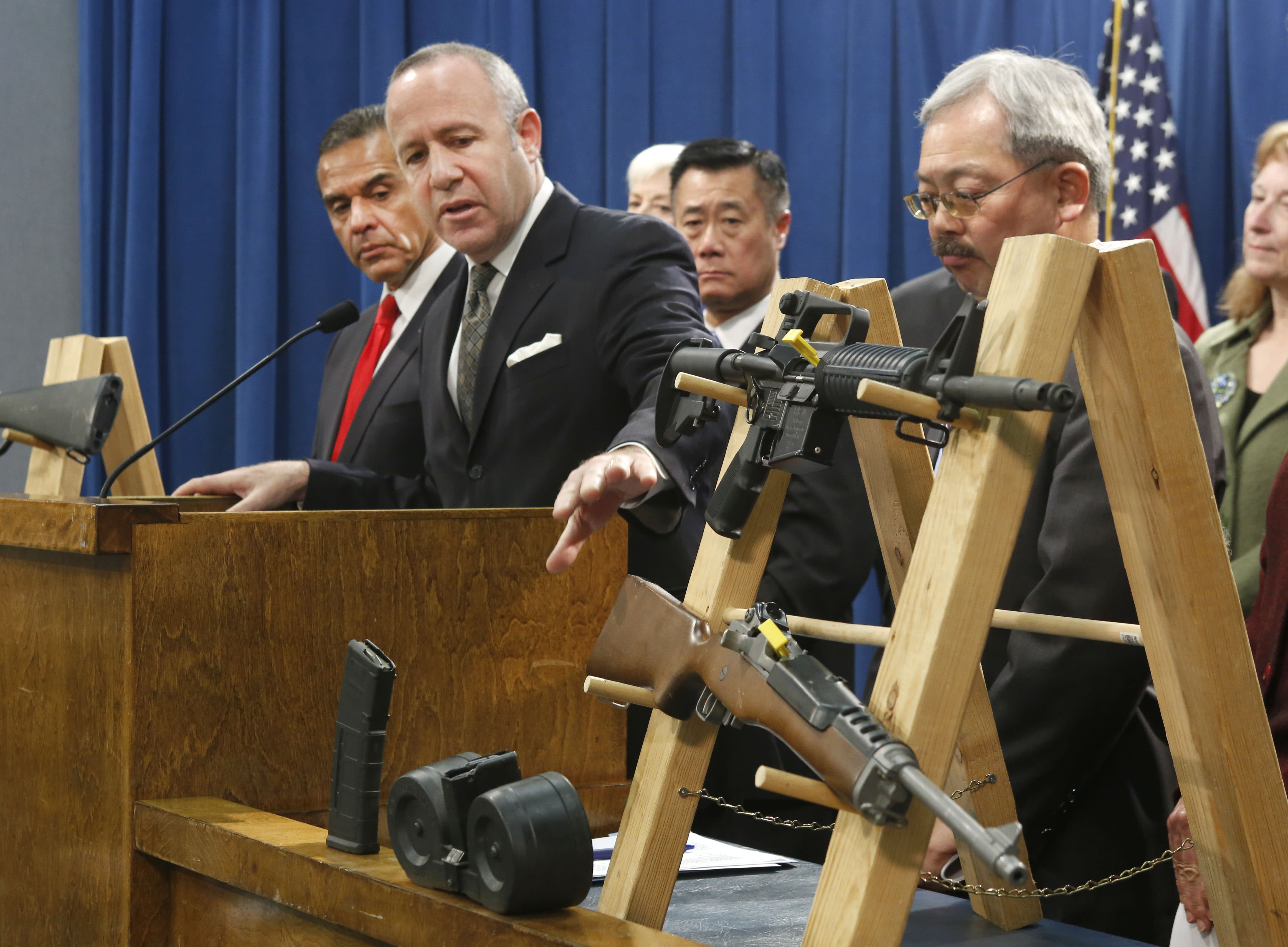 Senate President Pro Tem Darrell Steinberg, second from left, glances to a pair of semi-automatic rifles as he discusses a package of proposed gun control legislation at a Capitol news conference in Sacramento, Calif., Thursday, Feb. 7, 2013. Senate Democrats unveiled a package of 10 proposed laws designed to close loopholes in existing gun regulations, keep firearms and ammunition out of the hands of dangerous person and strengthen education relating to firearms and gun ownership. Also seen are Los Angeles Mayor Antonio Villaraigosa, left, Sen. Leland Yee, D-San Francisco, third from left, San Francisco Mayor Ed Lee, second from right. (AP Photo/Rich Pedroncelli)