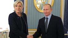 Putin welcomes Le Pen to Moscow with a nudge and a wink
