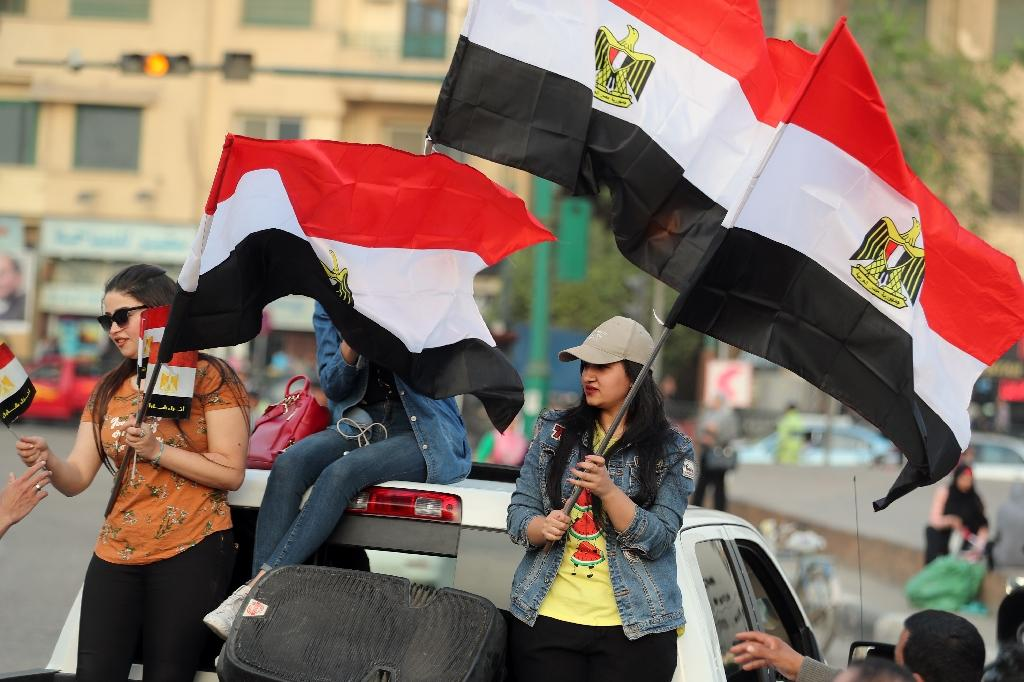 Supporters of Egyptian President Abdel Fattah al-Sisi celebrate in Cairo's Tahrir square following his re-election for a second term with 97 percent of the vote (AFP Photo/MOHAMED EL-SHAHED)