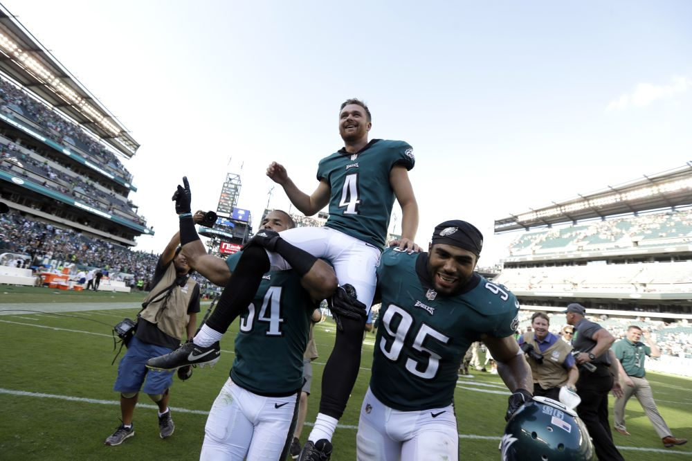 Philadelphia Eagles' Jake Elliott is carried off the field after kicking a 61-yard game-winning field goal. (AP)