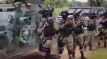 Mexican drug cartel shows off uniformed troops with military weapons and armoured vehicles in video