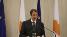 Cyprus says committed to peace talks, but not at gunpoint