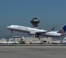 United Airlines raises profit forecast, trims capacity expansion