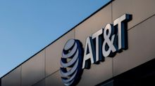 AT&T Falls as Investors Digest Merger, Smaller Dividend Payout