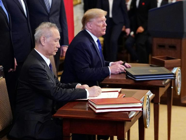 Chinese Vice Premier Liu He signed the trade pact with Donald Trump at the White House, providing some much-needed relief to global markets as tensions between the economic superpowers ease for now