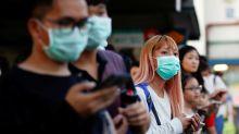 Singapore threatens prison for close encounters in stringent virus measures