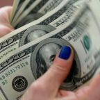 Dollar stabilizes ahead of earnings, U.S. consumer data