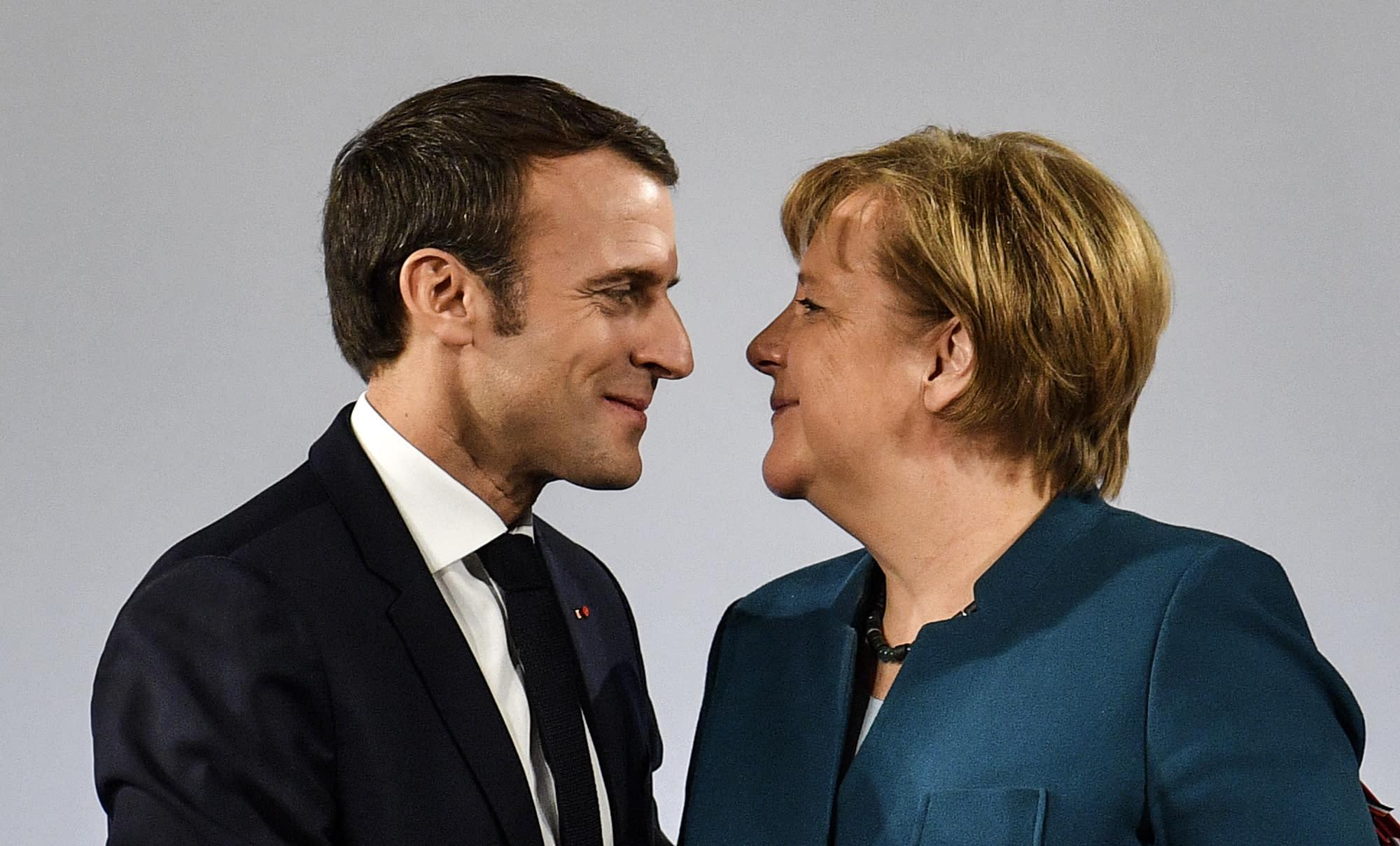 Angela Merkel Topless germany, france renew friendship treaty, warn of nationalism