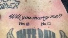 Man proposes to girlfriend with tattoo