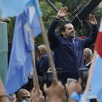 Hariri says resignation on hold, pledges to stay in Lebanon