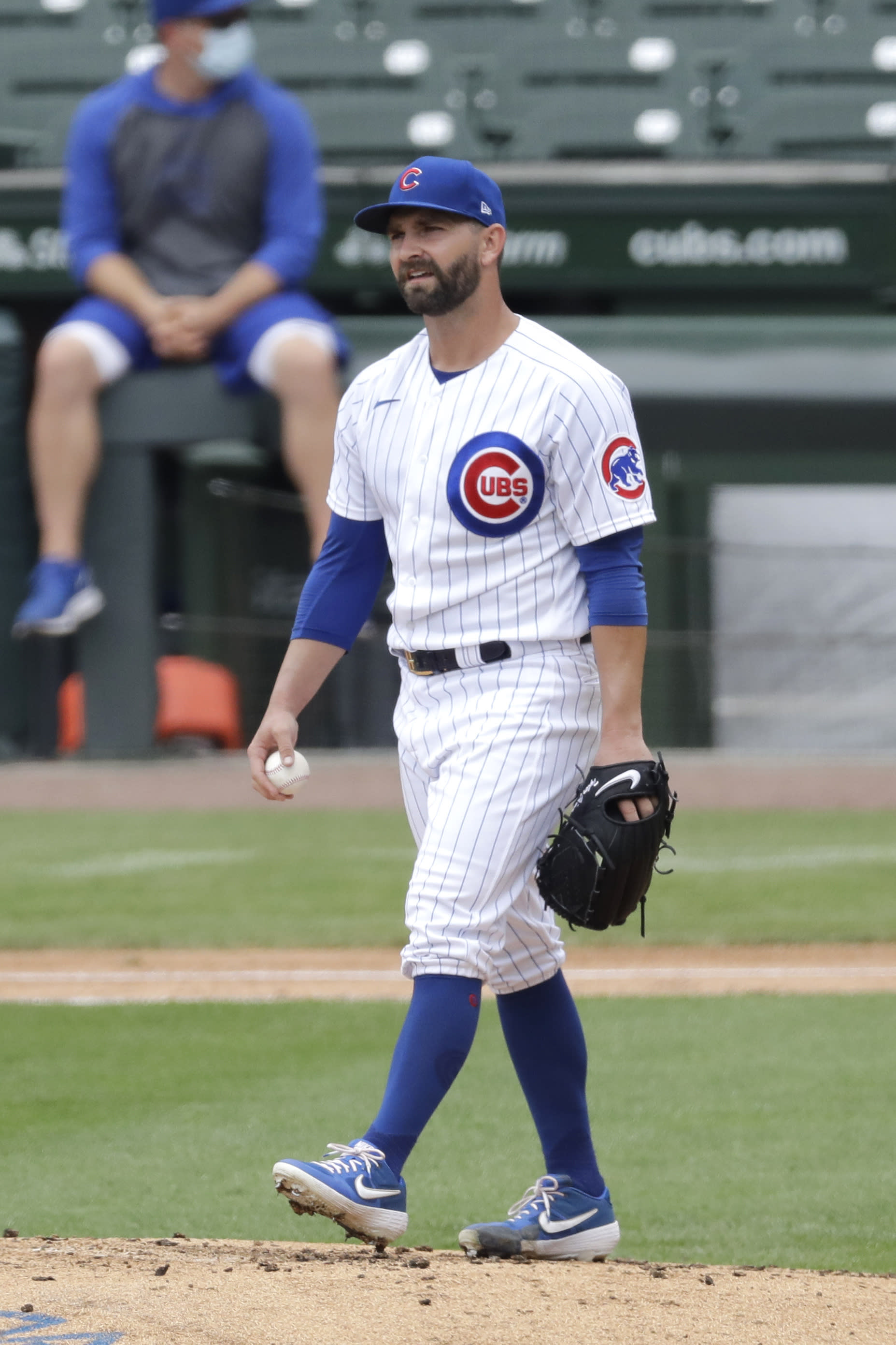 Chicago Cubs pitcher Tyler Chatwood reacts after Ian Happ hit a three-run home run during an intra-squad baseball game at Wrigley Field in Chicago, Wednesday, July 15, 2020. (AP Photo/Nam Y. Huh)