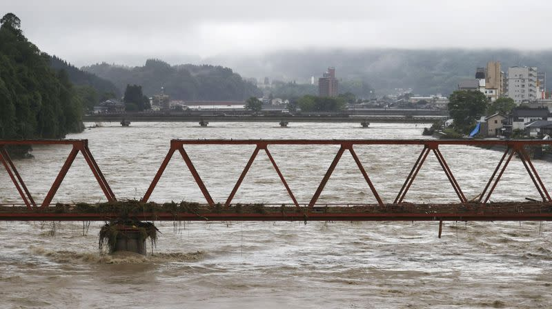 Photo shows a swollen Kuma River in the flood-ravaged city of Hitoyoshi