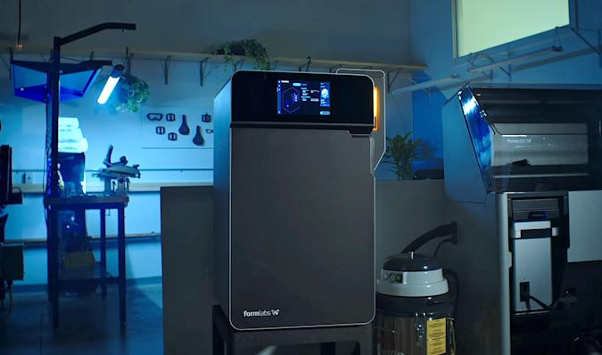 The new Formlabs SLS 3D printer is shown in a work enivironment.
