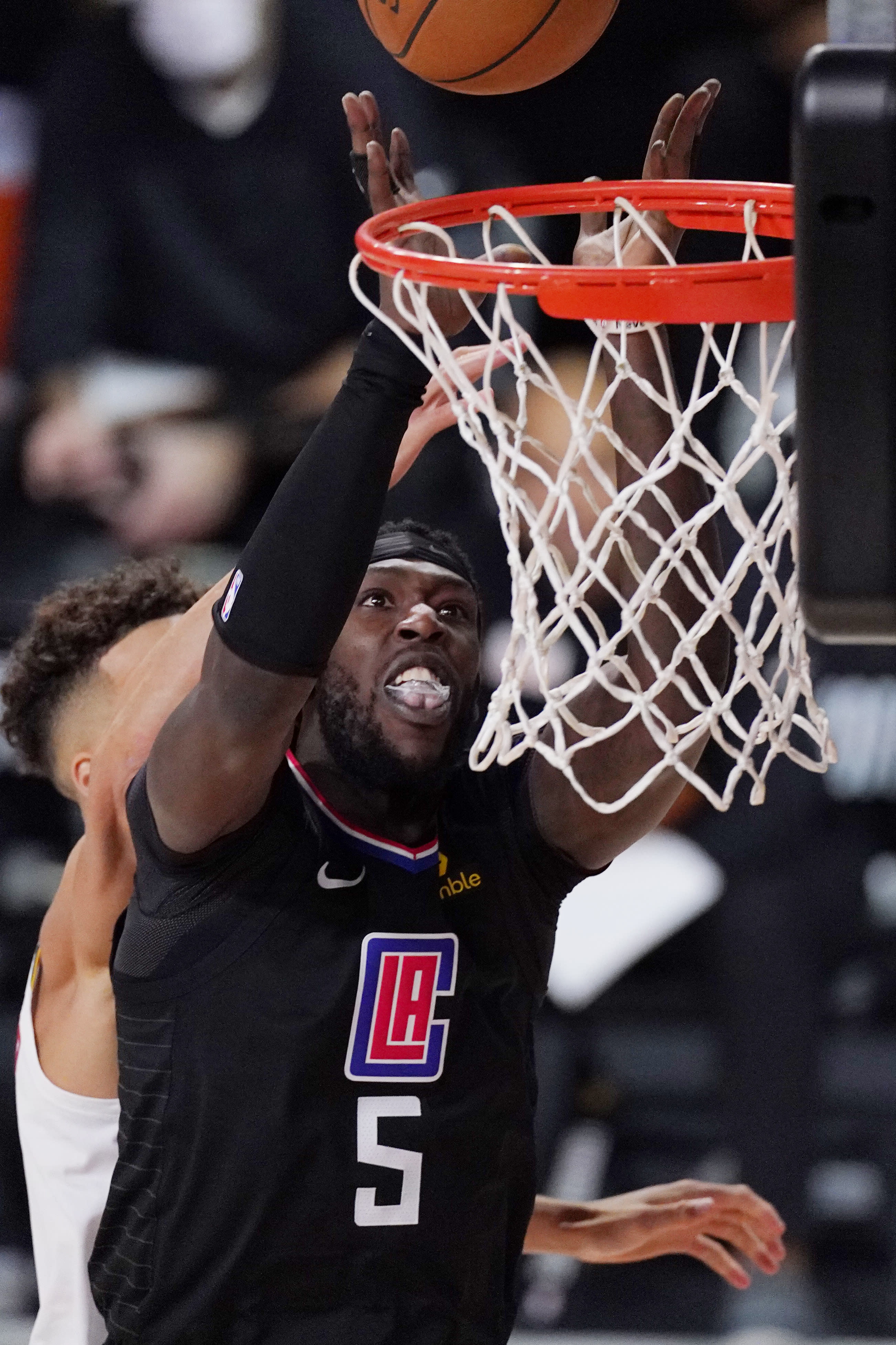 Los Angeles Clippers' Montrezl Harrell (5) shoots in front of Denver Nuggets' Michael Porter Jr. (1) in the second half of an NBA conference semifinal playoff basketball game Thursday, Sept 3, 2020, in Lake Buena Vista Fla. (AP Photo/Mark J. Terrill)