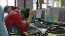 Nifty, Sensex end lower after RBI cuts rates
