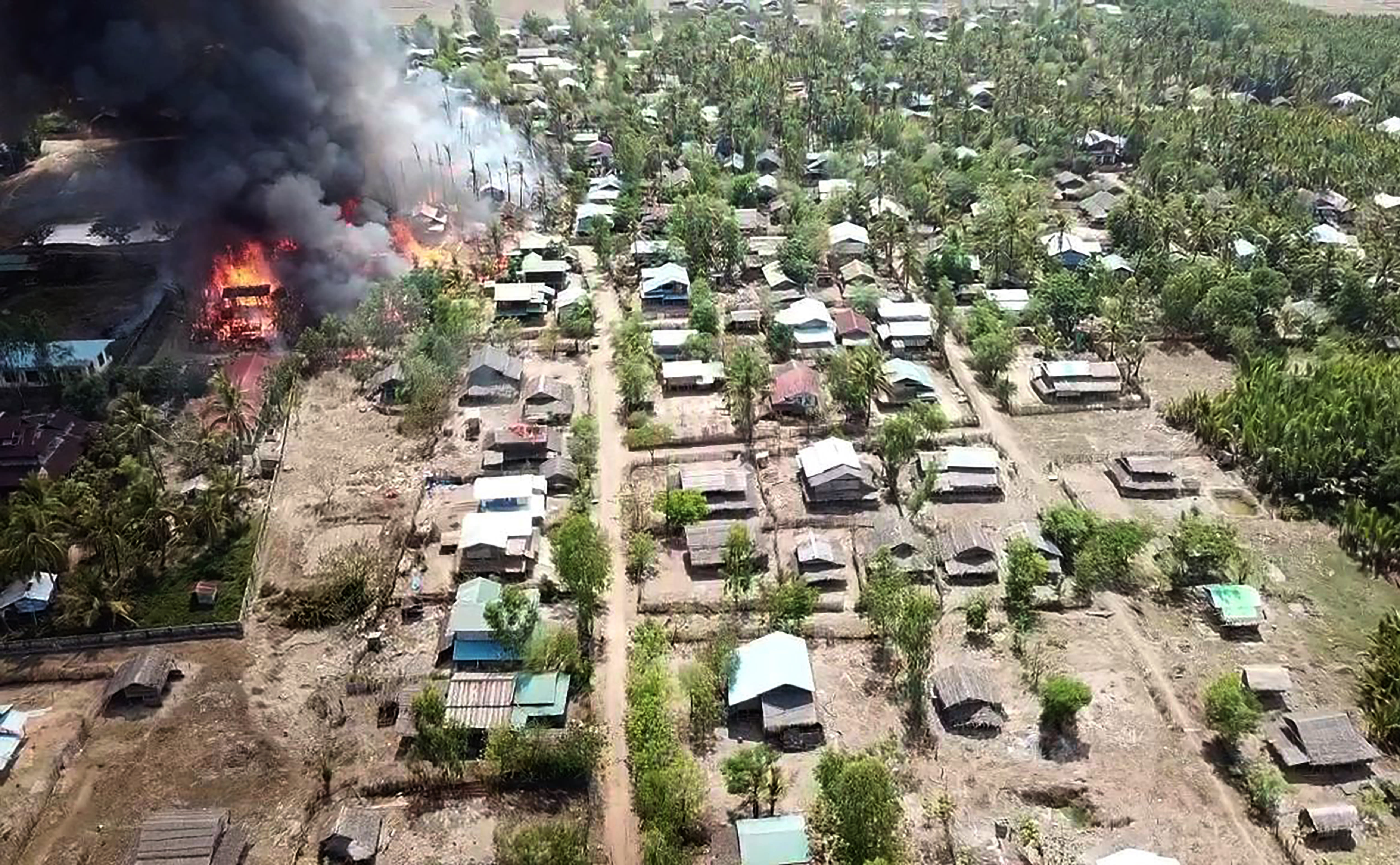 In this photo released by the Myanmar Army, a fire burns May 16, 2020, in the predominantly ethnic Rakhine village of Let Kar in Rakhine State's Mrauk-U township, western Myanmar. The Rakhine areas since January last year has been the scene of bitter armed conflict between the government and the Arakan Army, a guerrilla force of the Rakhine ethnic minority seeking greater autonomy for the state. (Myanmar Army via AP)