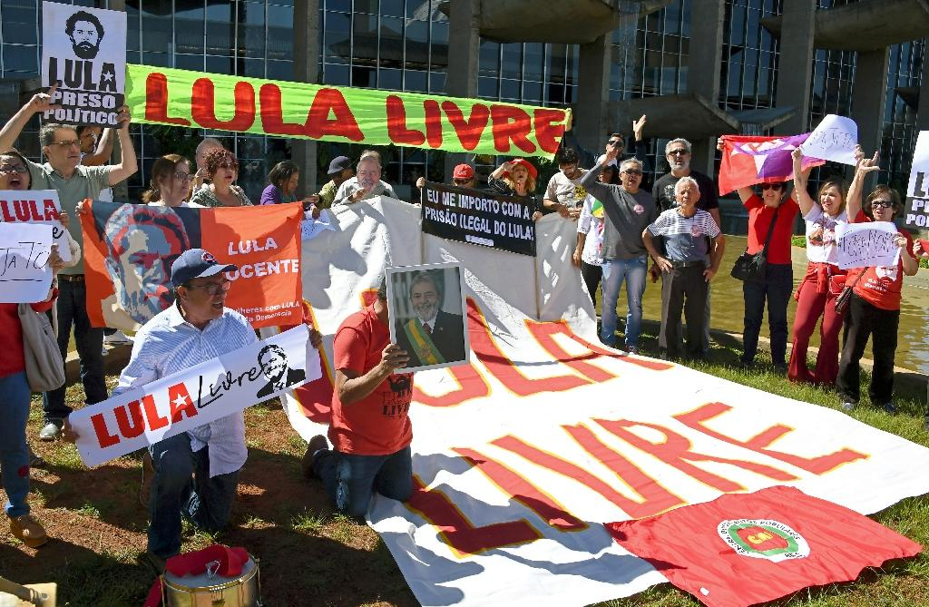 Demonstrators protest in front of the Justice Ministry in Brasilia calling for the release of former President Luiz Inacio Lula da Silva and the arrest of Justice Minister and former judge Sergio Moro on June 10, 2019