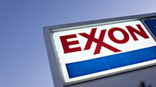 Exxon Logs Record Writedown, Slashes Spending Plan