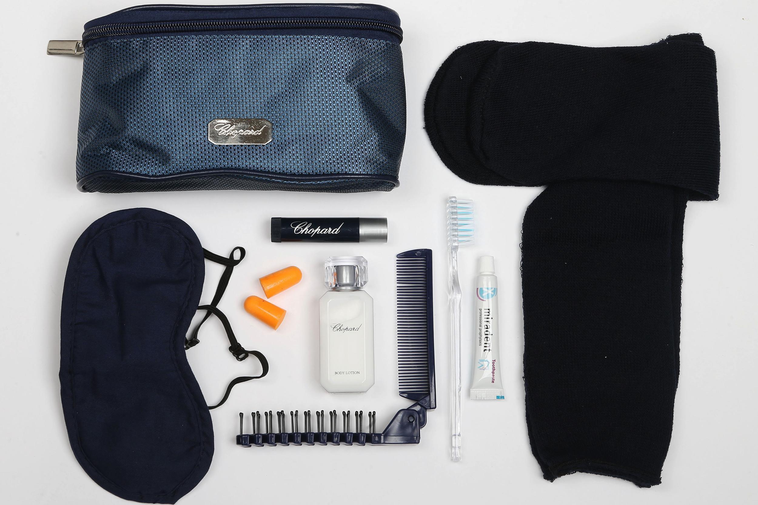 <p><strong>What do you get?</strong> Socks, eye mask, ear plugs, comb/brush, toothbrush, toothpaste, Chopard lip balm and body lotion<br /> <strong>Best bit of the kit?</strong> Chopard skin care products kick this amenity kit up a notch.</p>