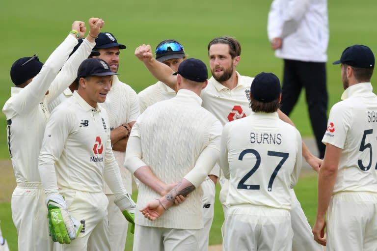 Chris Woakes celebrates taking the wicket of Pakistan captain Azhar Ali (AFP Photo/Dan MULLAN)
