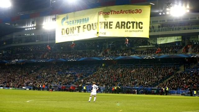 Greenpeace protesters interrupt Champions League match