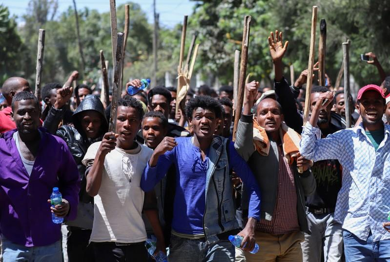 FILE PHOTO: Oromo youth chant slogans during a protest in-front of Jawar MohammedÕs house, an Oromo activist and leader of the Oromo protest in Addis Ababa