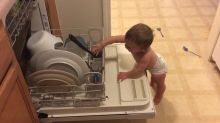 """Baby """"helps"""" mommy with the dishes"""