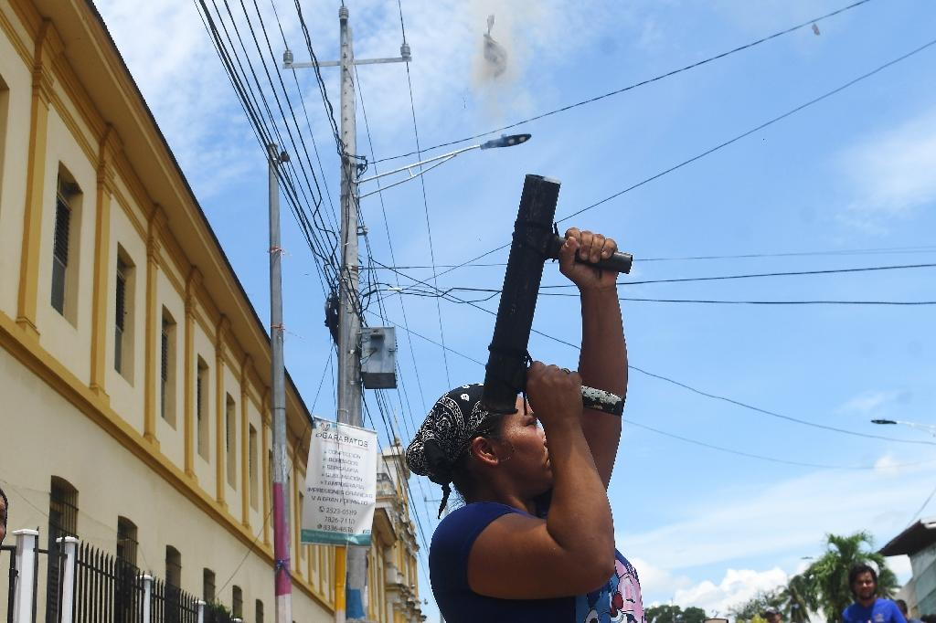 An anti-government protester fires a home-made mortar during a demonstration in the Nicaraguan city of Masaya, one of the flashpoints in the crisis