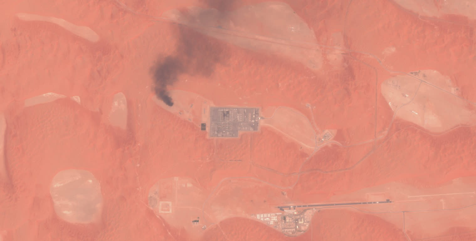 "This Saturday, Aug. 17, 2019 false-color image from the European Commission's Sentinel-2 satellite that was processed by Sinergise's Sentinel Hub website shows smoke rising from a natural gas facility at the Shaybah oil field in Saudi Arabia after a drone attack claimed by Yemen's Houthi rebels. Drones launched by the Houthis attacked a massive oil and gas field deep inside Saudi Arabia's sprawling desert on Saturday, causing what the kingdom described as a ""limited fire"" in the second such recent attack on its crucial energy industry. (European Commission via AP)"
