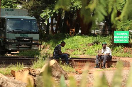 An armed prison guard is seen outside court during the appearance of Zimbabwean pastor Evan Mawarire (not in picture) at the Harare Magistrates court, Zimbabwe, February 3, 2017.REUTERS/Philimon Bulawayo
