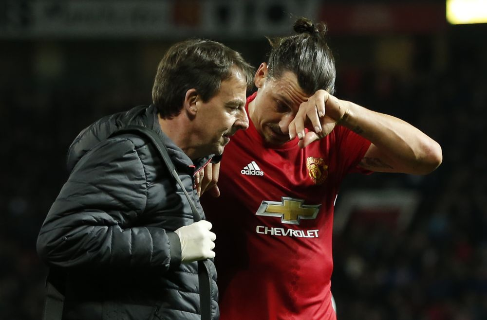 Manchester United's Zlatan Ibrahimovic receives medical attention