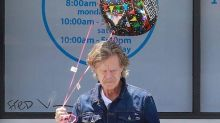 William H. Macy holds graduation balloons as daughter involved in college admissions scandal completes high school