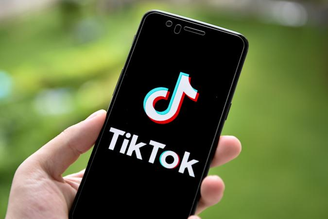 CHINA - 2020/09/20: In this photo illustration a TikTok logo is seen displayed on a smartphone. (Photo Illustration by Sheldon Cooper /SOPA Images/LightRocket via Getty Images)