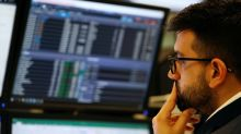 Defensive stocks help European shares end flat, London lags